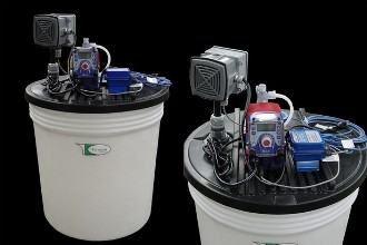 Flow-paced chlorine injection package with 30 gallon tank and a Walchem EWB pump paced by an in-line flowmeter. Local alarm annuciator standard.